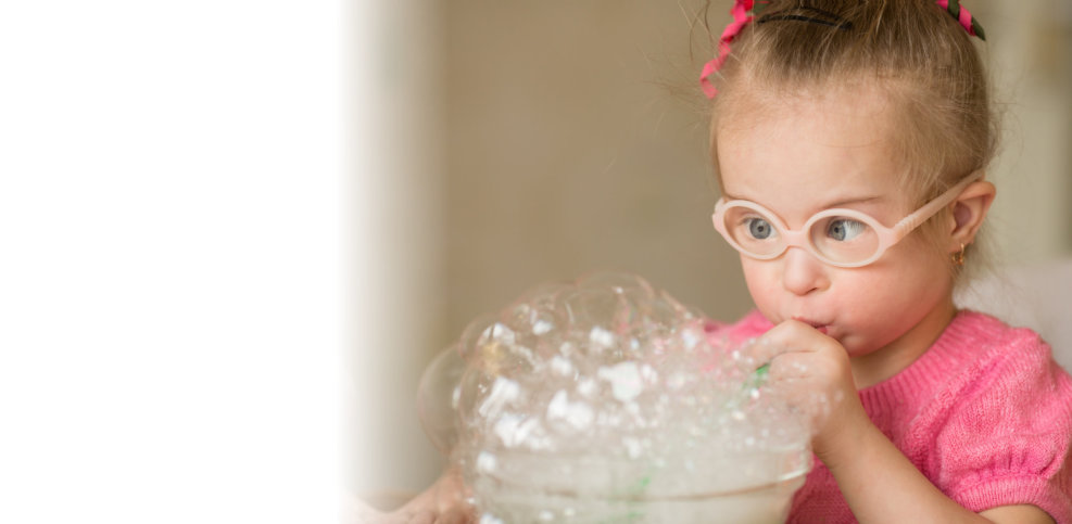 little girl playing bubbles