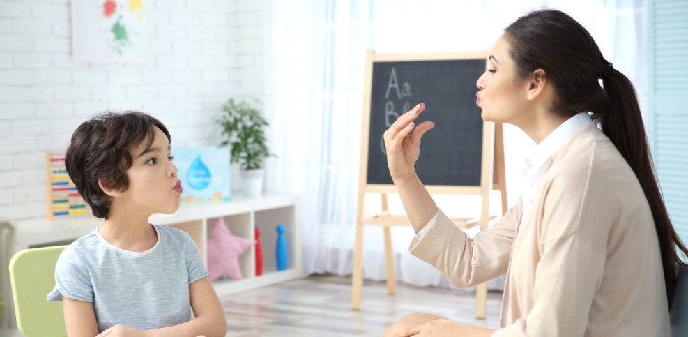 little girl and teacher in session